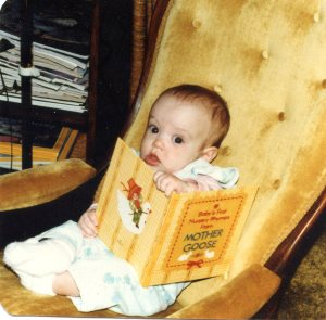 Me at four months old, desperately grasping my favorite book